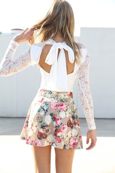 skater type floral skirt, bare back with a bow, lace... do you still want more?