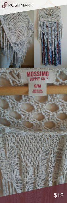 """NWOT Boho Crochet Fringe Poncho Crochet poncho from Mossimo Supply Co. in off-white color. 100% acrylic. About 38"""" right-to-left and 28"""" long in center. Size S/M, but I usually wear a large on top, and I'd say it still fits me quite well. New without tags.  Please check out the rest of my listings. I offer a discount on ALL bundles and fast shipping! Everything is from a smoke-free home. Mossimo Supply Co. Sweaters Shrugs & Ponchos"""