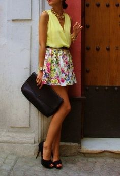 Yellow blouse tank, floral skirt, black peep-toe heels, gold chain jewelry, black clutch.