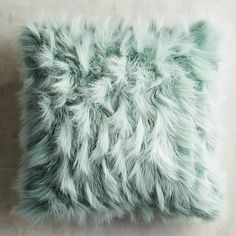 Fabulously fluffy, our faux fur pillow is as cozy as it is fashionable, boasting plenty of texture in a pretty blue hue. Plus, it's priced just right, so you won't even bat an eye at buying more than one.