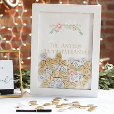 White guest signature shadow box personalized with choice of 2 custom lines of print, monogram and date, or large single initial with gold and silver wooden signature hearts