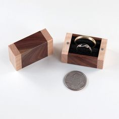 Handmade wooden ring box for one ring or two rings. Hand made of recycled curly maple wood and black walnut wood. This would be perfect for a ring bearer, rings are secured with black foam inside and the two halves of the box pop open and snap shut with magnets.