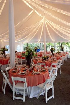 Love this reception tent and colors minus the awkwardly tall center pieces.
