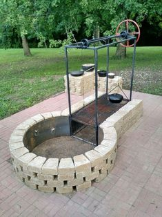 ideas backyard fire pit bbq projects for 2019 Fire Pit Grill, Diy Fire Pit, Fire Pit Backyard, Backyard Patio, Backyard Landscaping, Bbq Grill, Fire Pit For Cooking, Sloped Backyard, Backyard Designs