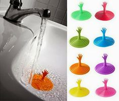Awesome Help Me Drain Stopper: LOVE THIS!! I HATE sticking my hand into cold, yucky, greasy dish water. Awesome and cute to boot!