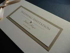 Gold & Ivory Wedding invitation - cheque book style with a personalised cover and ribbon bow