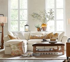 The PB Air Slipcovered 4-Piece Sofa Chaise in a neutral upholstery is the perfect backdrop to play up warm tones and weathered woods found in our Relaxed Rustic aesthetic.