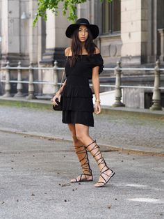 How to Wear High Gladiator Sandals this Summer | Street Style Outfit Inspiration | @NotYourStandard in all-black outfit