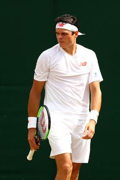 Milos Raonic of Canada looks on against Mackenzie McDonald of the United States during their Men's Singles fourth round match on day seven of the Wimbledon Lawn Tennis Championships at All England Lawn Tennis and Croquet Club on July 9, 2018 in London, England.