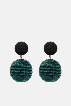 Rebecca de Ravenel's search for the perfect statement earrings led her to create Les Bonbons: a collection of featherweight adornments that are as striking as they are whimsical. Made by hand in India, this pair dangles beaded green orbs from button-like forms wrapped in black silk cord. Finished with silver-plated brass clip backs.