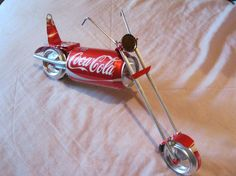 I built this chopper out of 10 cans.It measures 14x7x3.It is put together with rivets and copper wire.