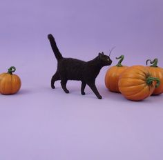 http://www.ebay.co.uk/itm/Wizard-a-OOAK-Realistic-Handmade-Miniature-Black-Halloween-Kitty-Cat-Sculpture-/131977827695?_trksid=p2047675.l2557