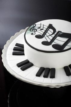 To make things easier you can always print a musical image to apply to the cake. It looks like this may be what was done here. Then just add a few three dimensional pieces and you are set Music Cake by Divan #piano #note #keys