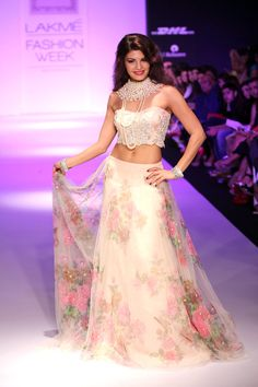 Jacqueline Fernandez looking beautiful in a off white lehenga accessorised with a heavy neck piece. #Bollywood #Style #Fashion #LFW