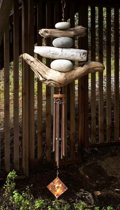 Maybe use small hagstones? Wind Chime Driftwood Beach Stones Copper Chimes