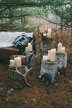 Event Decor Tree Stumps with Candles. To-Do: Natural un-treated tree stumps are to be placed around the designated outdoor seating areas of the venue. On top of each stump there will be large cream colored led candles that will illuminate the outdoor space. *Note: No Hurricane Glass Jars will be used outdoors, and no real candles will be within reach of any children. #weddingcandlesoutdoor