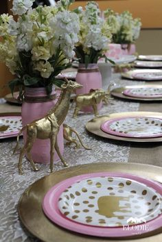Pink and gold place settings at a safari birthday party! See more party ideas at CatchMyParty.com!