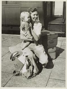 The war in Malaya. Refugees from Penang. Stirring tales of heroism and of lucky escapes were told by refugees from Penang on arrival at Ipoh Station, Perak. On their way to Singapore, a British woman evacuee with baby at Ipoh Station. 1941-42.