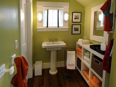 This fresh and fruity palette of green and orange is the perfect color combination for this small, narrow bathroom.