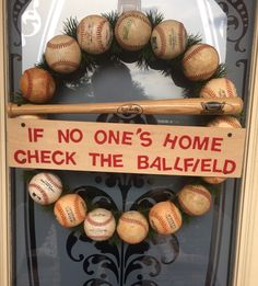 """Baseball Wreath -  materials needed: 17 baseballs, red felt letters, artificial grass, 18""""wood craft ring,bat, a piece of wood wide enough to attach to the baseballs, & screws. Electric drill to attach craft ring to balls, the board to balls &bat handle by drilling the screw through the bat & into the ball. Hot glued the grass between the balls and the other end of bat to ball. It is heavy, so for hanging, you need a heavy duty hook. Good luck, it was fun to make, it was a family project!"""