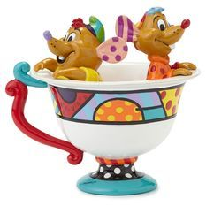 In this colorful figurine designed by pop artist Romero Britto, mice Jaq and Gus hide inside a teacup as they scheme to rescue Cinderella.