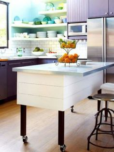 If the home youre buying doesnt come with a center island purchase a free standing one like this.  You can move it all around the kitchen!
