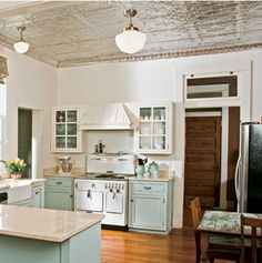 We have the tin ceiling & wood floors, now to paint the cabinets these colors. Gorgeous!