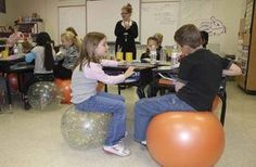 Stability balls as chairs in the elementary classroom.  Yes, please.