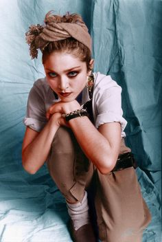 A scarily young Madonna looking like a sort of tough pixie, photographed by Laura Levine, 1982.