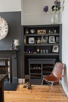 Idea for bar area... Dark paint with wine rack?