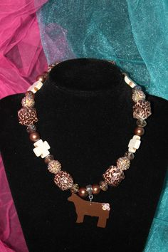 Sass N' Stones - Cheetah w/ Steer Pendant, $42.95 (http://sass-n--stones.mybigcommerce.com/cheetah-w-steer-pendant/)