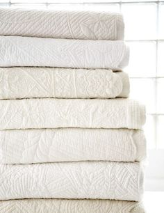 Classic white-on-white trapunto quilts. I would like to learn this art of quilting.I would add alittle more color though.