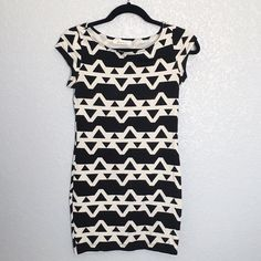 "MODERN TRIBAL PRINT BODYCON Black and cream modern tribal print tunic/dress. Measures approx. 29"" length (measured flat). Lightweight. Perfect for spring/summer. 95% cotton, 5% spandex/elastane. Condition: excellent. Final sale.  ❌NO TRADES ❌No Offsite Transactions ✅ All Price Negotiations are handled strictly through the OFFER Feature Only. Lowball offers will be ignored ✅ BUNDLE TO SAVE! Forever 21 Dresses Mini"