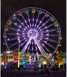 Behold a LED lit Ferris Wheel at the 2016 NY EDC Festival. #leds #ferriswheel #art #nyc #green