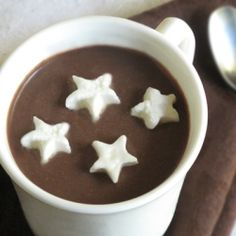Delicious rich bourbon hot chocolate with adorable boozy whipped cream stars. A perfect fireside treat for snuggling with your sweetheart!