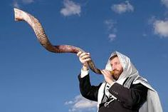 shofar - a trumpet made from a Rams horn used in Jewish worship to herald in the Jewish New Year