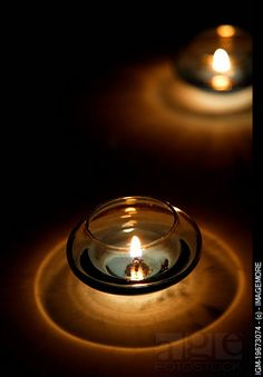 Lit candles in candle holders