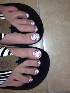 A cute pedicure design I had done with red, white, and blue .