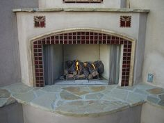 Two dragonfly tiles on each side of the firebox are made more impressive by plain/solid color tiles outlining the firebox