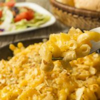 Sticky Peppered Velveeta Mac And Cheese  Indulge in this thick and sticky macaroni and cheese! This recipe is definitely a potluck favorite with its classic taste and peppery kick.