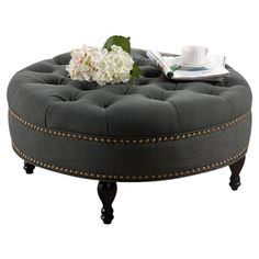 Lend a touch of classic appeal to your living room or master suite with this lovely cocktail ottoman, showcasing a button-tufted design and elegant nailhe...