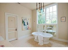 Smaller version of the same Italian Murano glass lights in bathroom of Dennis Quaid's home. CA Equestrian property