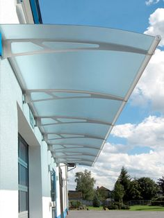 Lightline® Extendable Canopies: Extendable Canopies with blue tint panels on commercial application Awning Canopy, Backyard Canopy, Patio Canopy, Canopy Outdoor, Gate Design, Roof Design, Exterior Design, House Design, Front Door Canopy