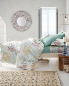 A dreamy painterly undersea landscape in soft watercolor shades is printed on our 310 thread count cotton sateen sheets