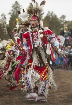 Navajo northern traditional dancer Brando Jack of White Cone, Ariz. dances during grand entry on Saturday afternoon, June 1, 2013, during the 16th Annual Powwow in the Pines in Pinetop, Ariz.  (Diego James Robles)