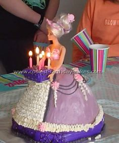 barbie holding a small cake. ideas: use a real small mini cake sitting on a cardboard and insert wooden dowels underneath OR decorate a small box to look like a little cake and cut holes into it for the candles
