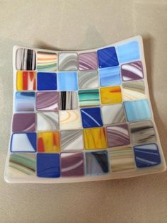 Quilt design using various colors and different streaked glasses slumped into a candy dish.