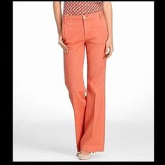 """Tory Burch High Rise Flair Jeans Nothing says spring like this vibrant orange shade Seventies- inspired high-rise flare jean. Made with perfect amount of stretch, has a flattering, wide-leg fit. Wear it like a neutral, pair it with anything  from vivid blouses for maximum colorblocking to basic tees for a pop of brightness. To showcase a longer leg, wedges or platforms give a retro look that feels very of-the-moment. Size 27 waist measures 13"""" flat across the front inseam is 34"""" rise is 9""""…"""