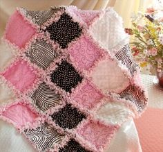 Pinned from http://www.kaboodle.com/reviews/pink-and-black-are-a-bold-and-beautiful-look-for-this-baby-rag-quilt-by-quilts-just-4-kids
