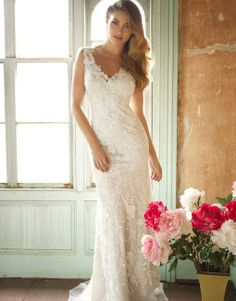 Style # 8800 | V-neckline, sheath, 2 piece gown with charmeuse satin lining and lace applique overlay. Lace overlay is adorned with embroidery and crystals.  | See Petals and Promises for sizing and availability.